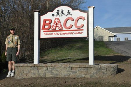 eagle scout helps with new bacc sign